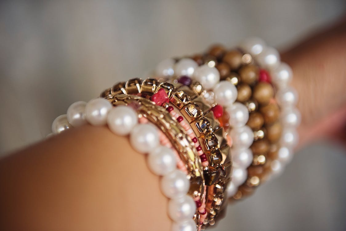 image of pearl and gold bracelets