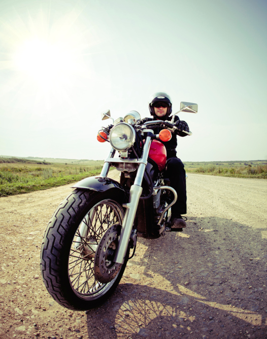 image of man riding motorcycle out in the country